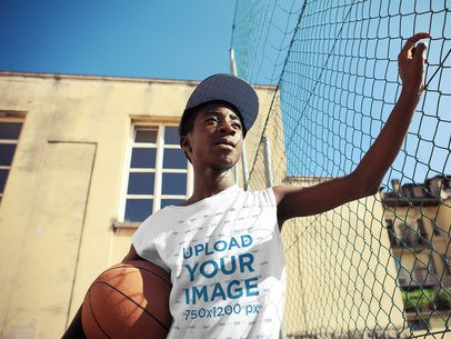 T-Shirt Mockup of a Teenager with a Basketball Ball 35226-r-el2