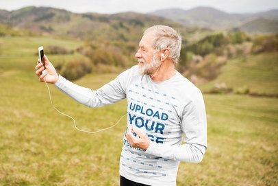 Long-Sleeve Tee Mockup of a Senior Man Taking a Selfie at the Mountains 39027-r-el2