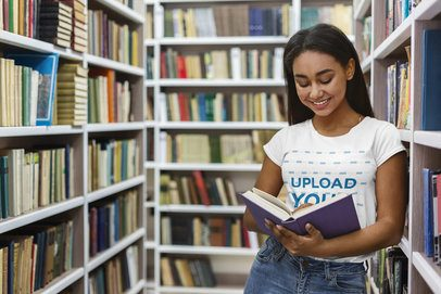 Crewneck Tee Mockup of a Young Student Reading in the Library 39189-r-el2