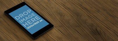 Nexus 7 Black Portrait Slanted Brown Wooden Desktop Shot Wide