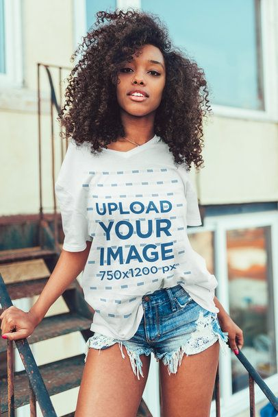 Mockup of a Young Woman Wearing an Oversized V-Neck T-Shirt 35196-r-el2