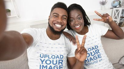 T-Shirt Mockup Featuring a Smiling Couple Taking a Selfie at Home 39099-r-el2