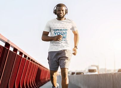 T-Shirt Mockup of a Man Wearing Headphones while Running on a Bridge 39363-r-el2