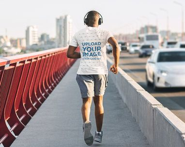 T-Shirt Mockup of an Athletic Man Running Away from the Camera 39362-r-el2