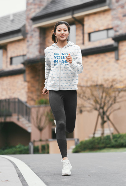 Full-Zip Hoodie Mockup Featuring a Smiling Woman Jogging 40096-r-el2