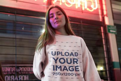 Sweatshirt Mockup of a Young Woman Posing on the Street 12684a