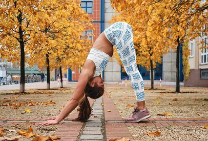 Leggings and Sports Bra Mockup of a Woman Doing a Standing Forward Bend 35025-r-el2