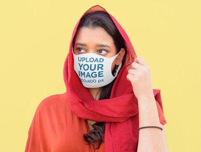 Mockup of a Woman Using a Face Mask at a Studio 39972-r-el2