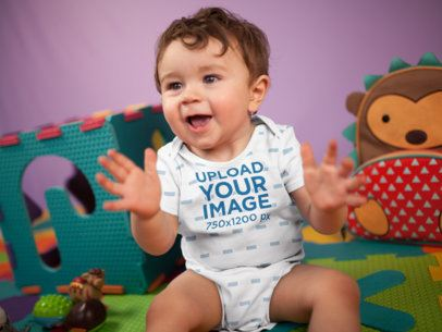 Happy White Baby Boy Clapping While Sitting Down Wearing A Onesie Mockup 16972