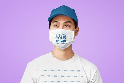 T-Shirt Mockup of a Man Wearing a Face Mask in a Studio Setting 41265-r-el2