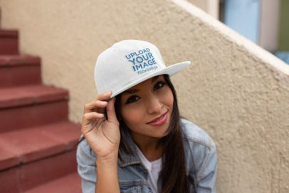 Mockup of Smiling Young Woman Wearing a Snapback Hat 11709