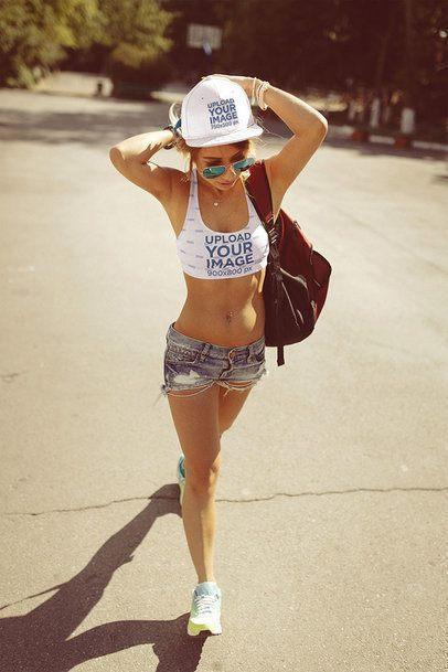 Mockup of a Woman Wearing a Sports Bra and a Snapback Hat 35217-r-el2
