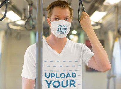 Face Mask Mockup of a Man Wearing a V-Neck Tee in the Subway 40336-r-el2