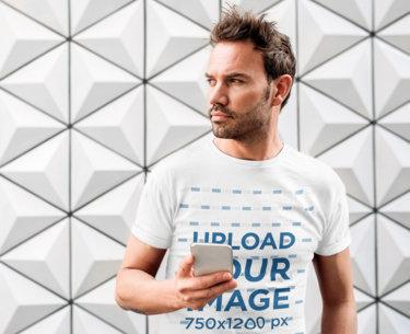T-Shirt Mockup of a Bearded Man Holding a Phone 35260-r-el2