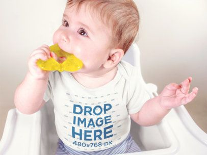 Baby Boy On His High Chair Wearing a Onesie Mockup a13961