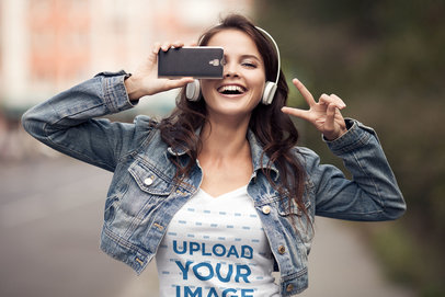 T-Shirt Mockup of a Young Woman Having Fun with Her Phone 38057-r-el2