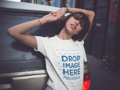 Trendy Girl Wearing A Round Neck Tee In The City While Lying Against An SUV Mockup a13570