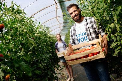 T-Shirt Mockup of a Man Holding a Box of Tomatoes 40658-r-el2