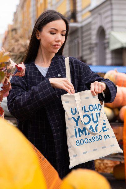 Tote Bag Mockup of a Woman Buying Pumpkins on the Street 41715-r-el2