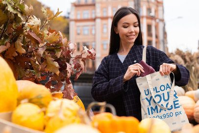 Tote Bag Mockup of a Happy Woman Buying Pumpkins 41752-r-el2