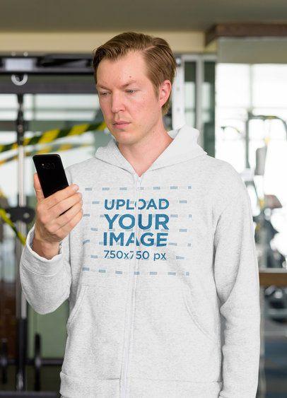 Mockup of a Man Wearing a Full-Zip Hoodie at the Gym 40035-r-el2