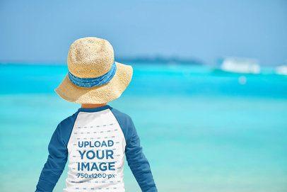 Back View Mockup of a Boy Wearing a Raglan Long-Sleeve Tee at the Beach 42013-r-el2