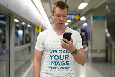 T-Shirt Mockup of a Man Looking at His Phone at the Subway Station 41165-r-el2