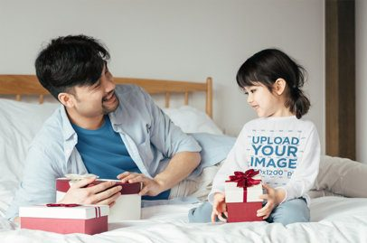 Long Sleeve Tee Mockup of a Girl and Her Dad Holding Christmas Presents 41964-r-el2