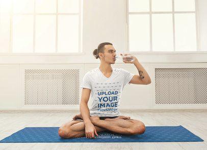 V-Neck T-Shirt Mockup of a Man Sitting on a Yoga Mat 41413-r-el2