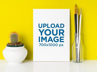 Art Print Mockup Placed Next to a Vase of Paint Brushers 36009-r-el2