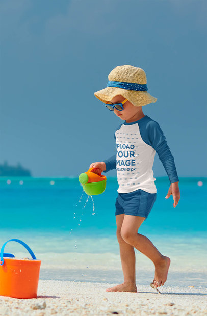 Raglan Long Sleeve Tee Mockup Featuring a Kid Playing at a Tropical Beach 42119-r-el2