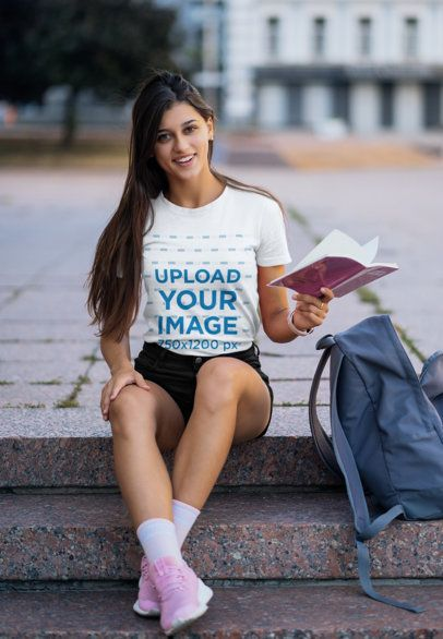 T-Shirt Mockup of a College Student Holding a Book 41382-r-el2