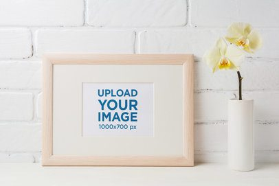 Mockup of an Art Print Placed Next to a Small Flower Vase 37137-r-el2
