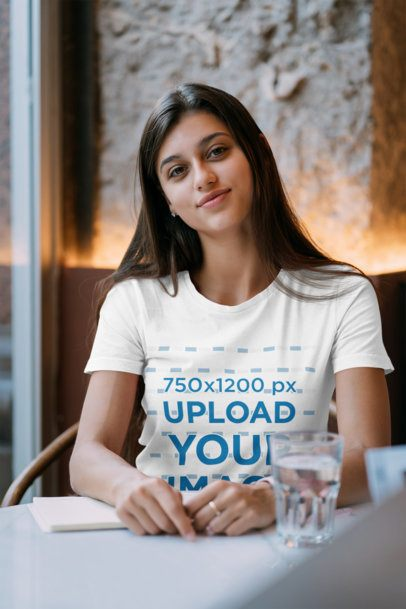 T-Shirt Mockup Featuring a Long-Haired Woman Studying at a Coffee Shop 41392-r-el2