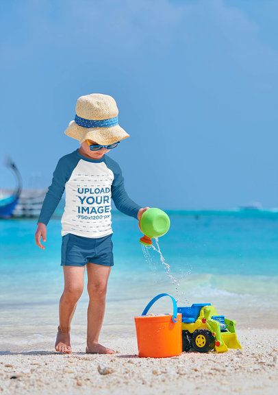 Mockup of a Little Boy with a Raglan Long-Sleeve Tee Playing in the Sand 42114-r-el2