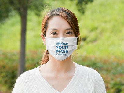 Face Mask Mockup Featuring a Young Woman at a Park 42732-r-el2