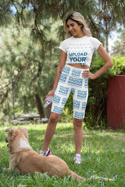 T-Shirt and Bike Shorts Mockup of a Fit Woman with a Dog 42387
