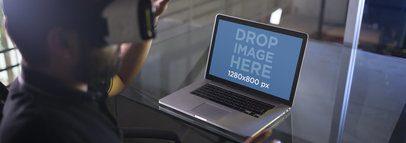 MacBook Mockup Featuring a Man Wearing an Oculus Gear VR Device a14246wide