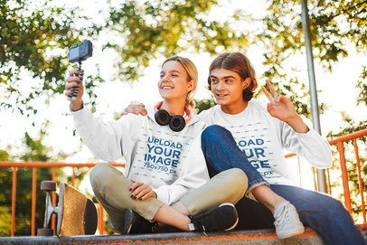 Sweatshirt and Hoodie Mockup of a Young Couple Taking a Selfie 43463-r-el2
