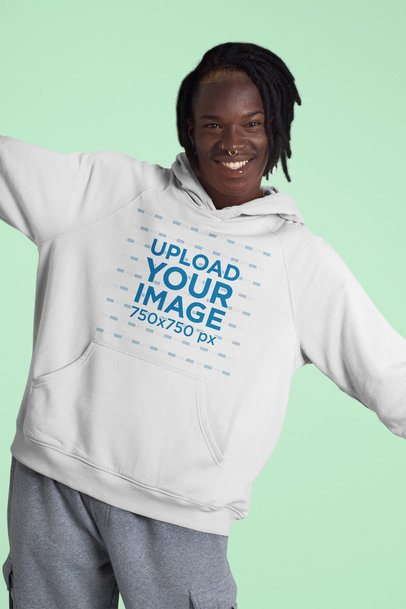 Hoodie Mockup of a Happy Man Posing Against a Plain Color Backdrop 42977