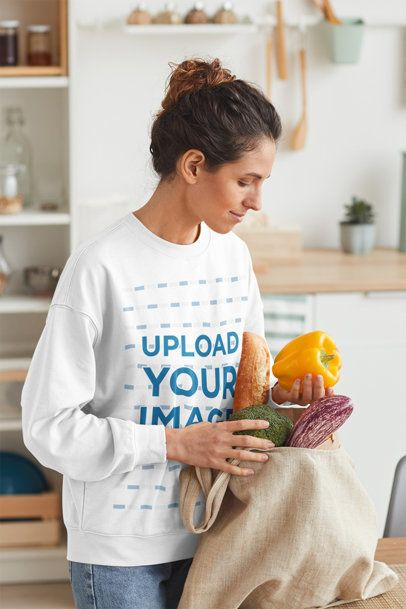 Sweatshirt Mockup of a Woman Unpacking Her Groceries at Home 41256-r-el2