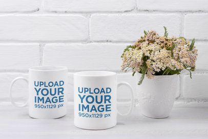 Mockup of Two Coffee Mugs Placed Next to Some Flowers 43570-r-el2