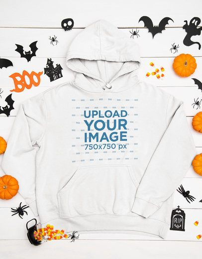 Mockup of a Flat Laid Pullover Hoodie Surrounded by Halloween Decor Items m94