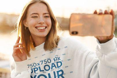 Crewneck Sweatshirt Mockup Featuring a Happy Young Woman Taking a Selfie 39826-r-el2