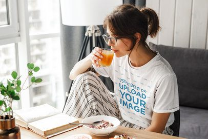T-Shirt Mockup of a Woman Reading While Having Breakfast 39776-r-el2