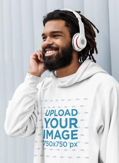 Pullover Hoodie Mockup of a Man Listening to Music on His Headphones 41724-r-el2