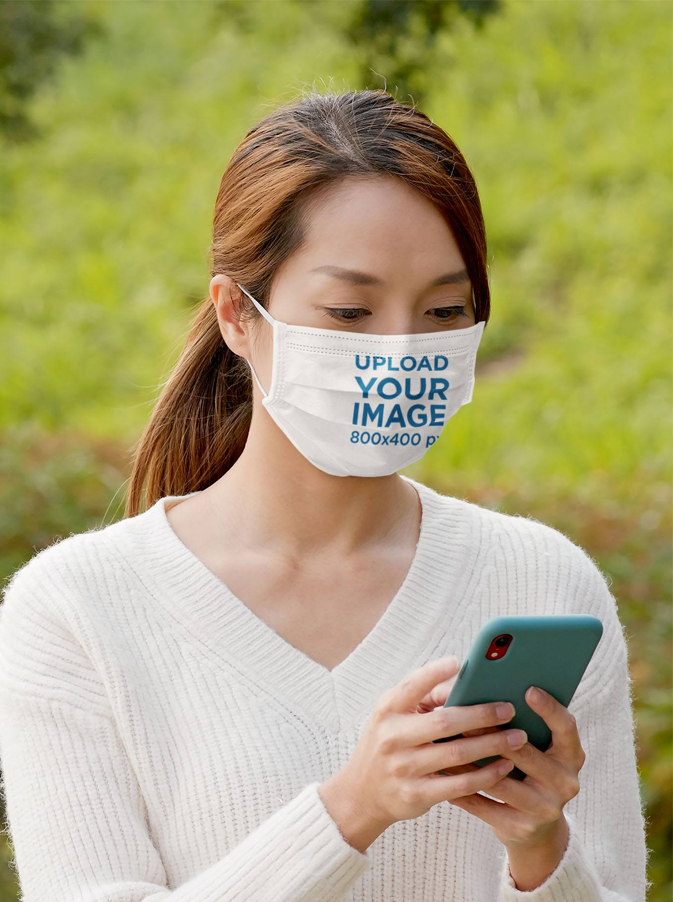 Face Mask Mockup of a Woman Checking Her Phone at a Park 44037-r-el2