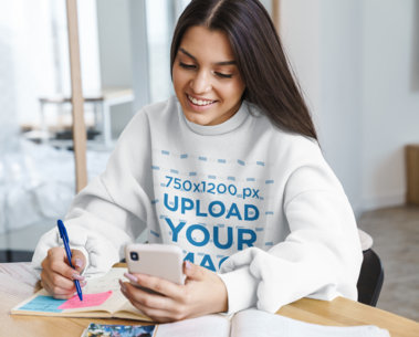 Sweatshirt Mockup of a Young Woman Checking Her Phone While Studying 41303-r-el2