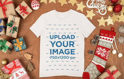 Mockup of a Flat Laid Tee Surrounded by Christmas Items m29