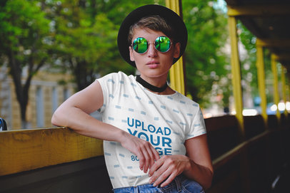T-Shirt Mockup Featuring a Serious Woman Wearing a Sublimated T-Shirt in a Tram 39686-r-el2
